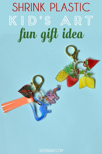 two key chains with childrens drawings laminated and punched holes to hang on chains