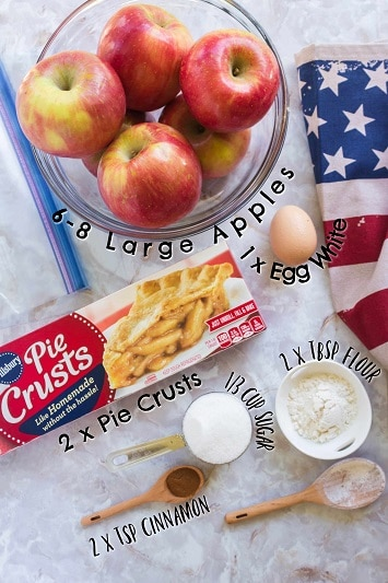 ingredients for apple pie.  apples, egg, pie crusts, sugar, flour and cinnamon