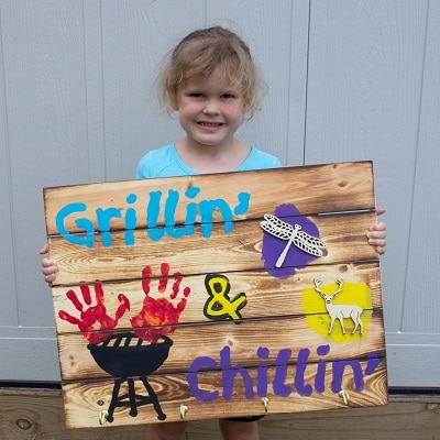 little girl holding homemade fathers day gift