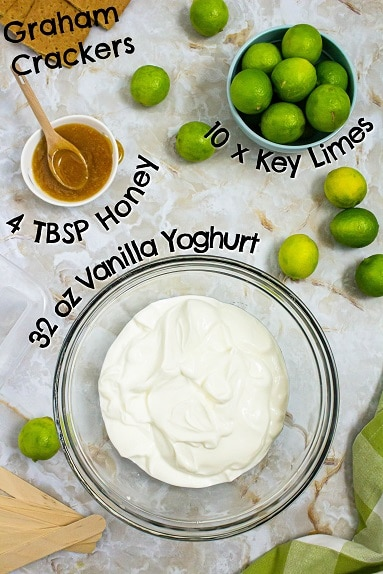 Image of ingredients for key lime pie popsicles - including yoghurt, key limes, honey and graham crackers