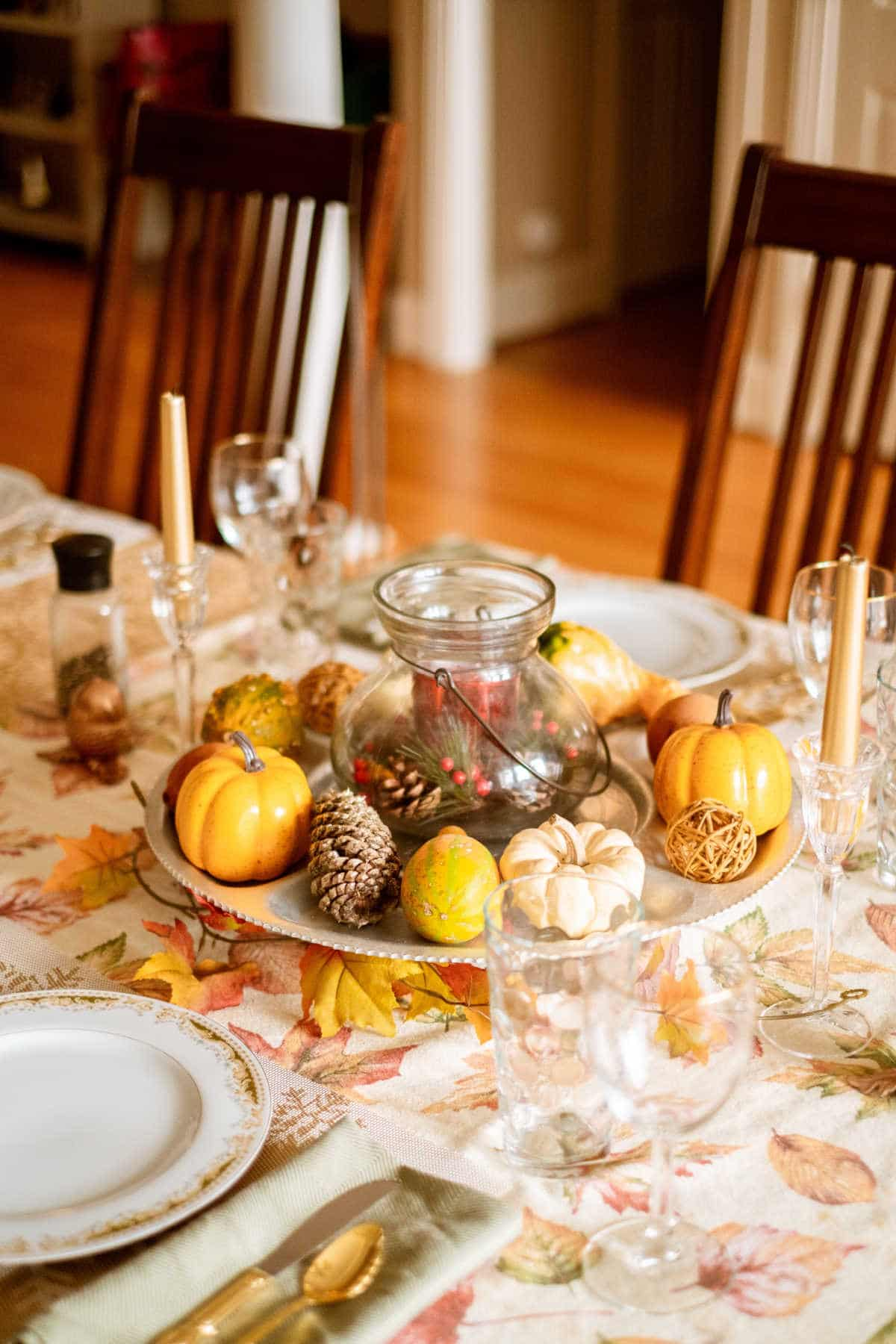 A beautiful thanksgiving dinner table decorated in the fall style