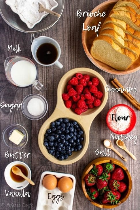 image with french toast ingredients, bread, milk, eggs, sugar, butter, vanilla, salt, nutmeg, flour, cinnamon
