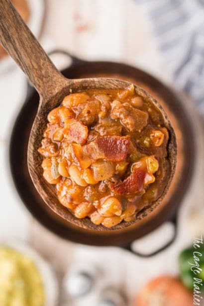 heaping spoon of baked beans with some bacon showing