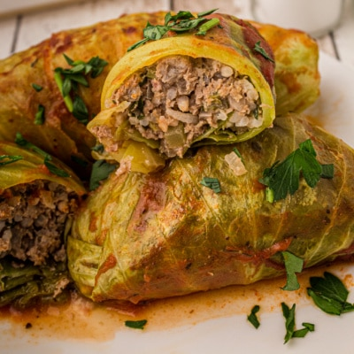cabbage rolls cut in half with inside of stuffed cabbage roll showing