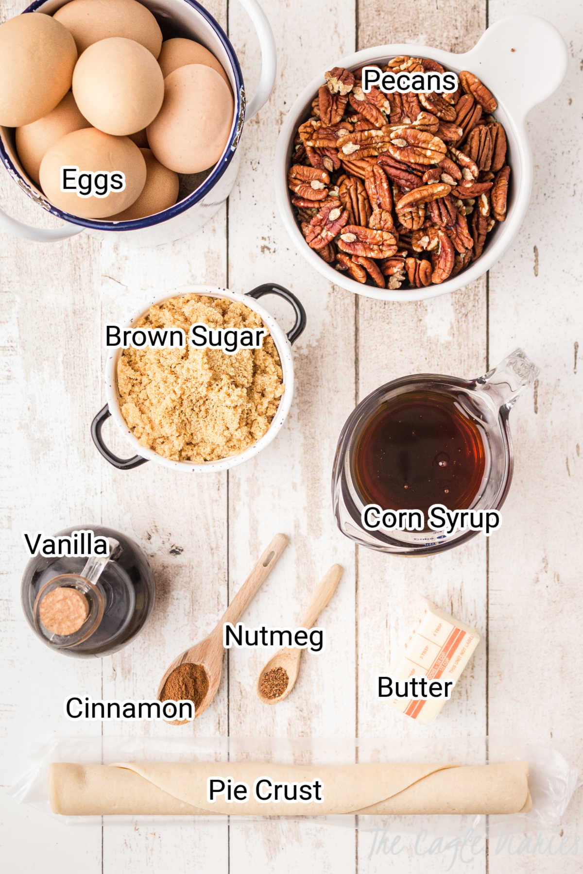 pecan pie ingredients laid out with the words on top