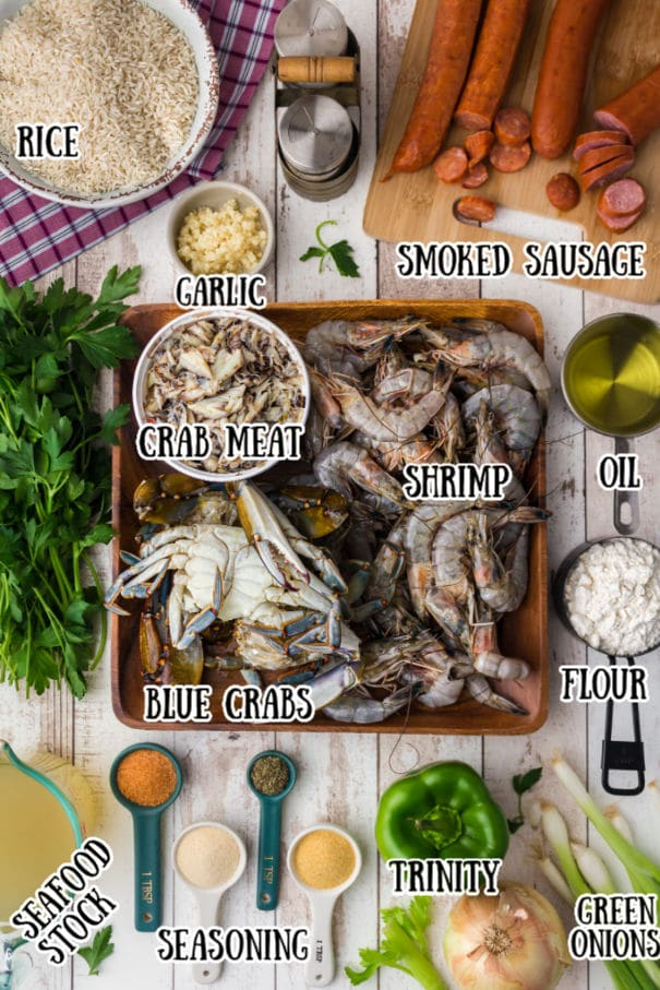 seafood gumbo ingredients all laid out with the names of the ingredients typed out