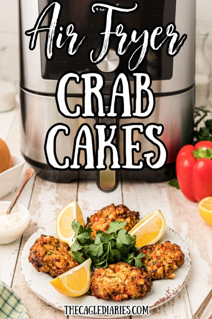 image with air fryer in the back ground, a plate with four crab cakes on it.