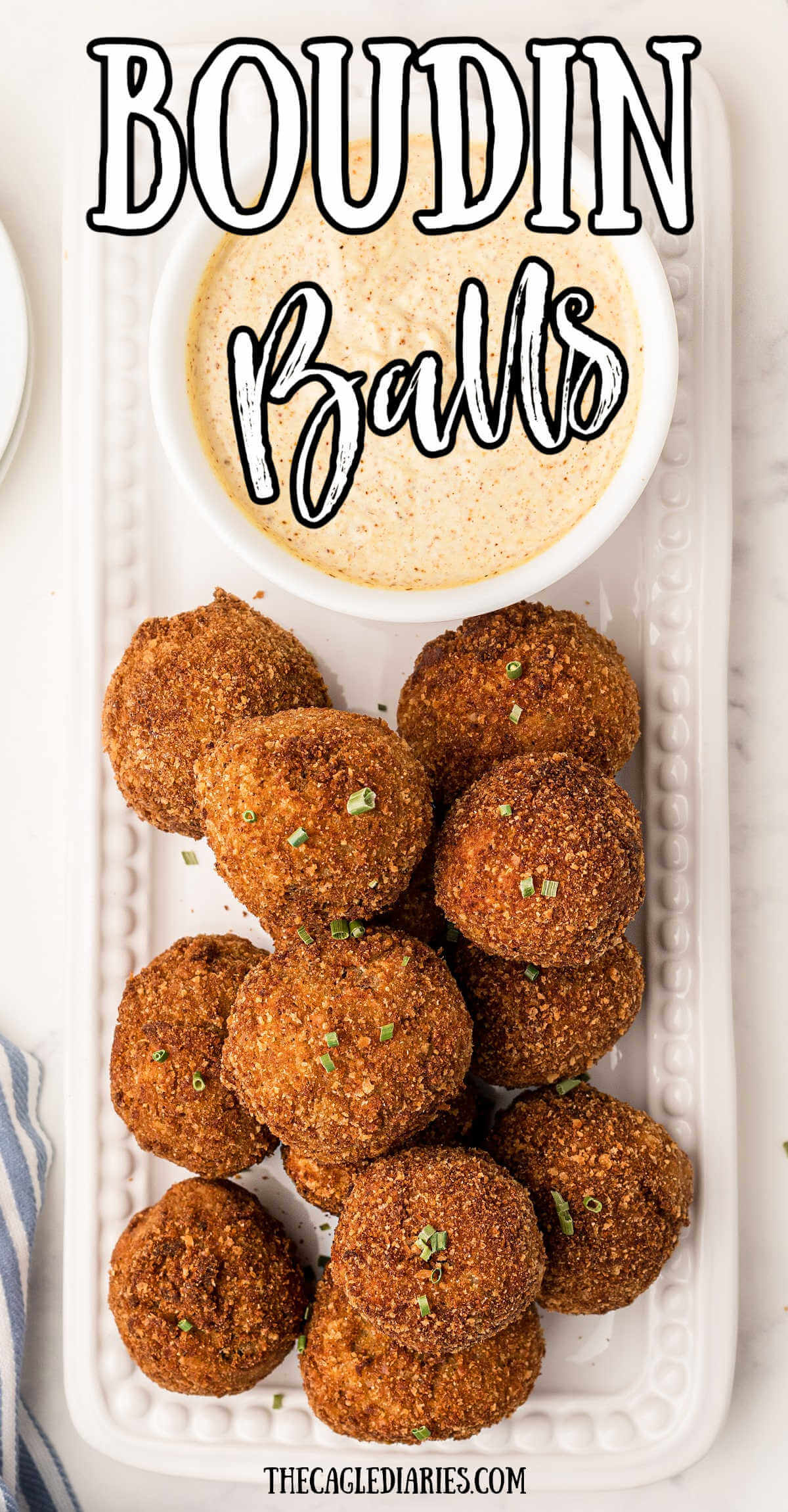 plate of boudin balls with a dip with the title boudin balls on top