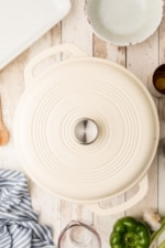 White dutch oven with lid covering