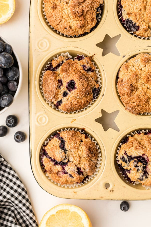 close up of lemon blueberry muffins in a muffin tray