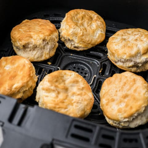 air fryer basket with biscuits inside