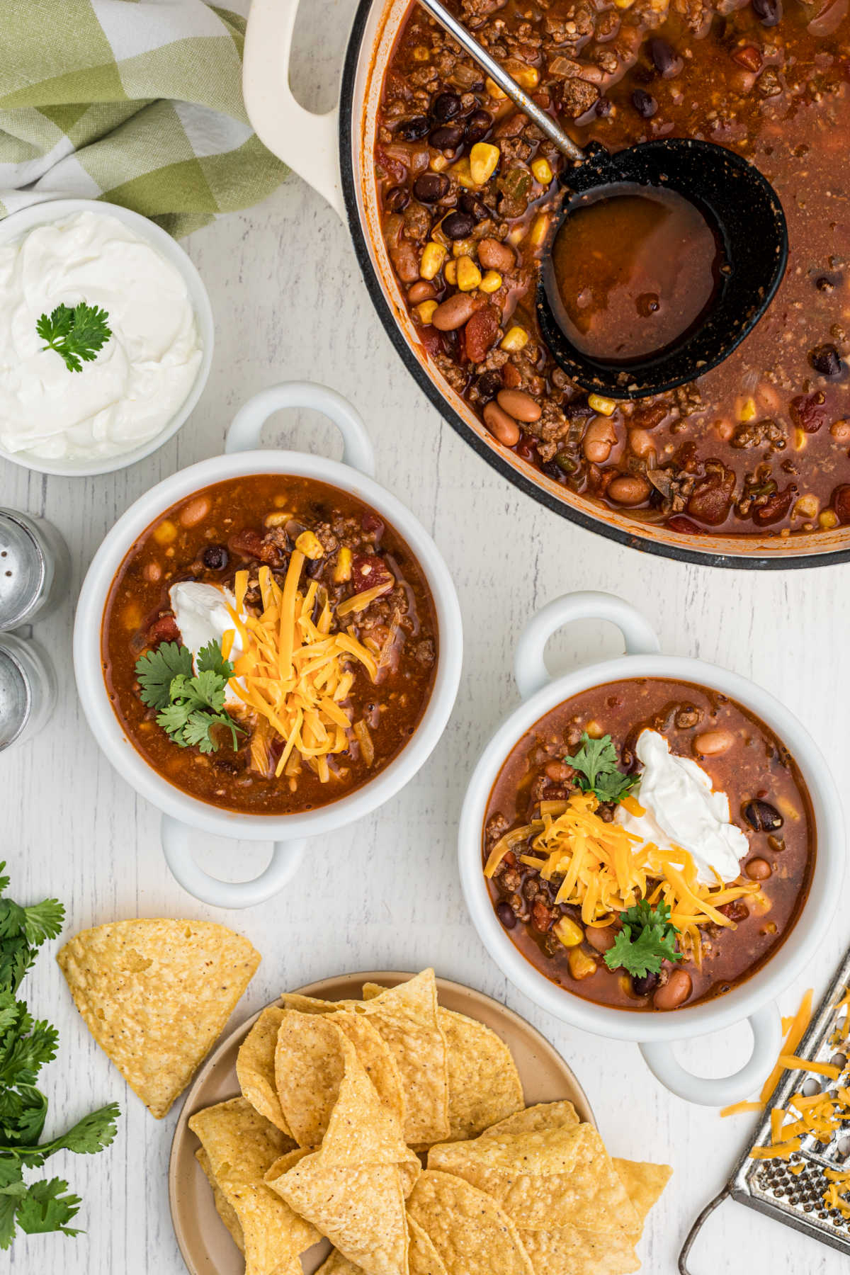 a pot of taco soup with two bowls dished out