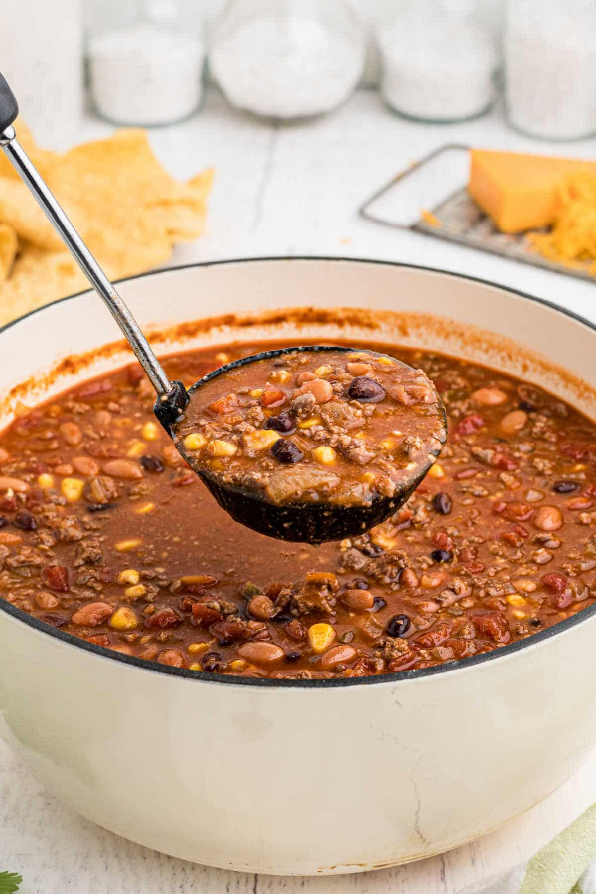 a large pot of taco soup with a ladle spooning out