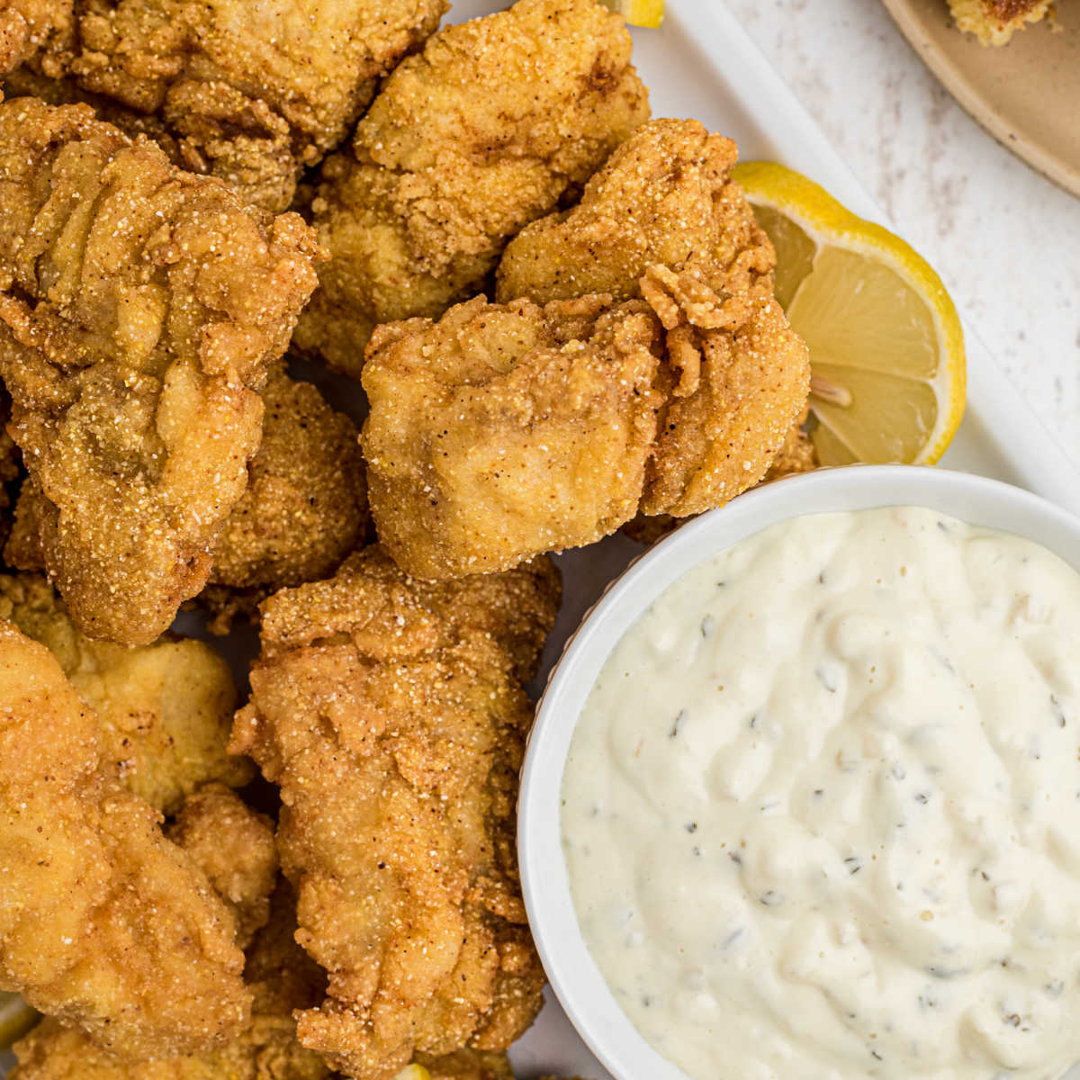 close up of some fried catfish nuggets with tartar sauce