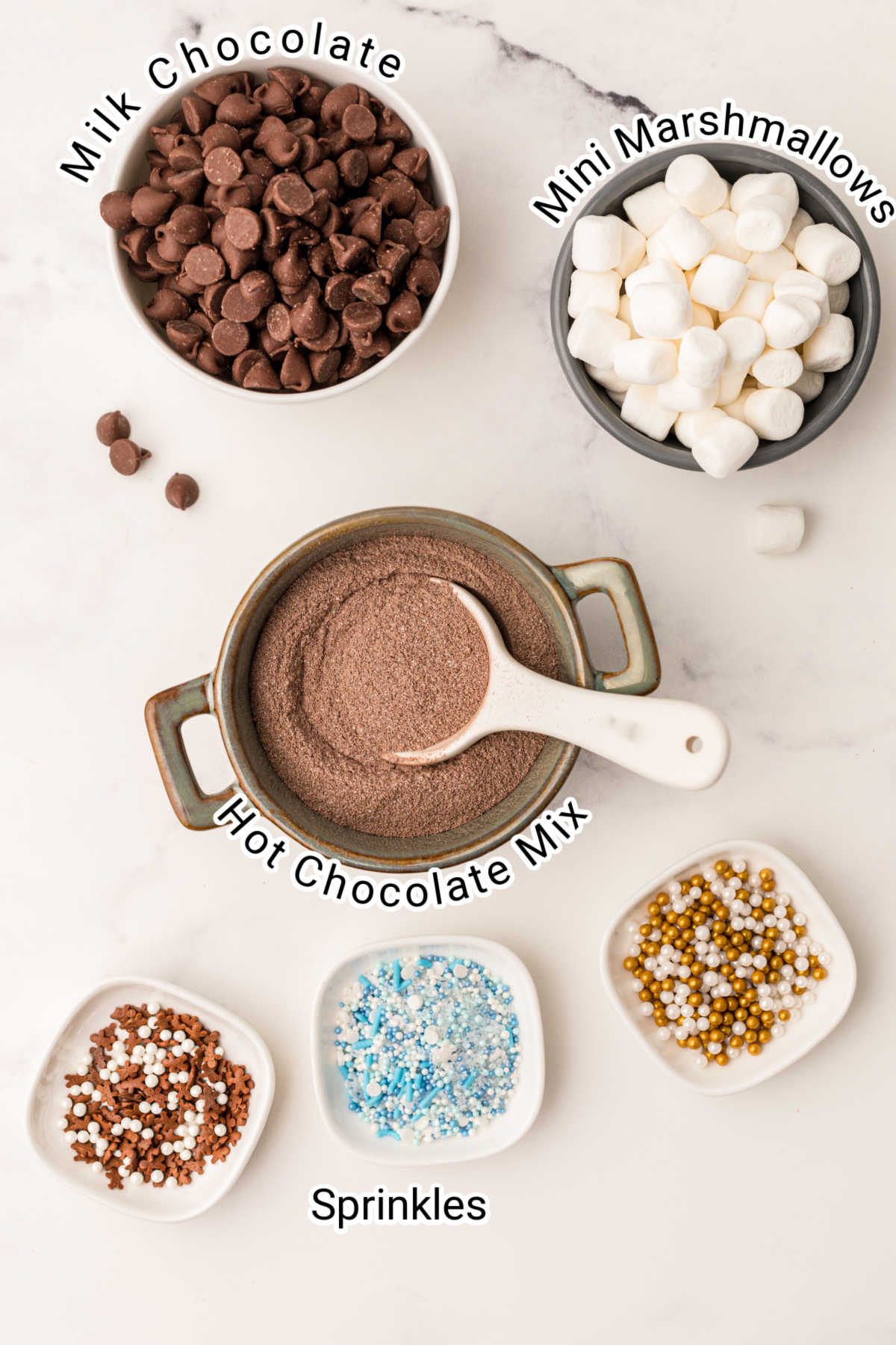 ingredients for hot chocolate balls laid out with their description typed over the top
