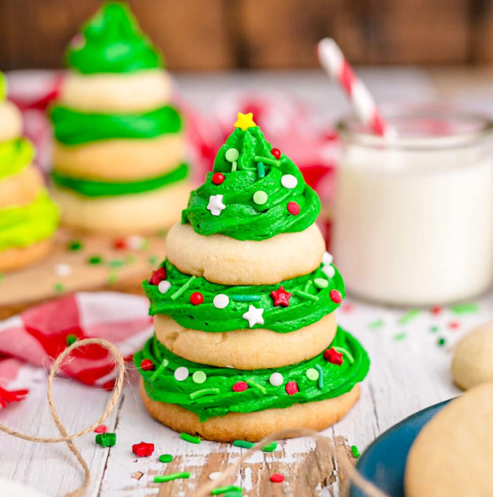 image of a stack of sugar cookies with green frosting that makes it look like a christmas tree