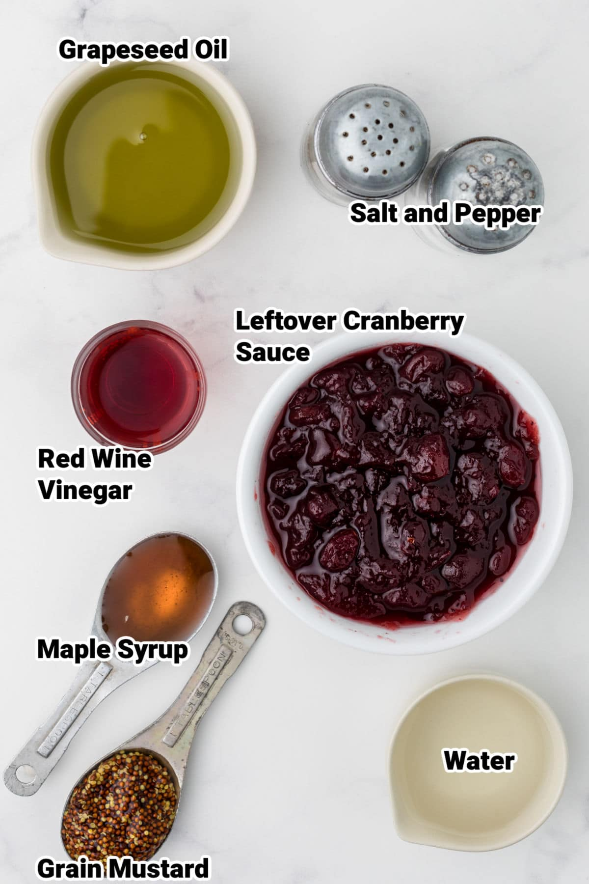 ingredients laid out for a cranberry vinaigrette