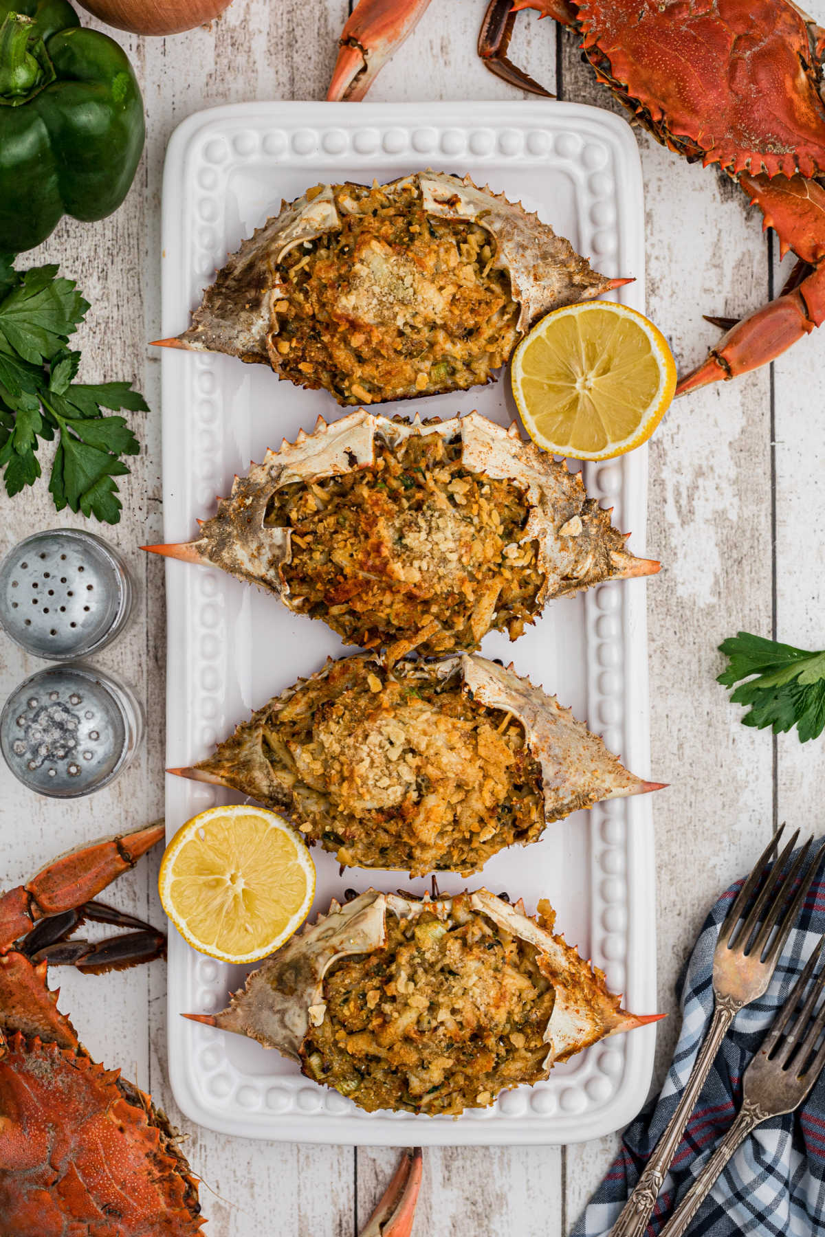 a long plate of stuffed crabs with some boiled crabs on the outside